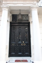 London black door flanked by columns